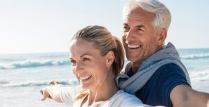 older_couple_beach_smiling